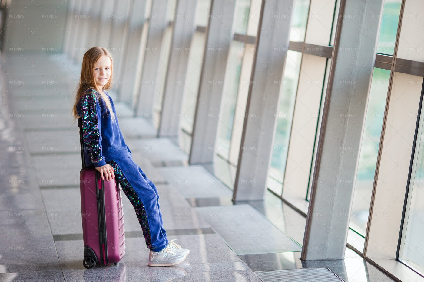 Little Girl In Airport: Stock Photos