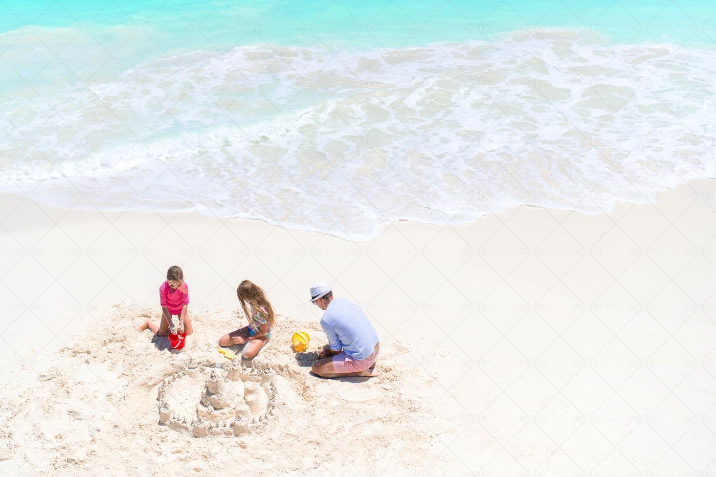 Family Building Sand Castles: Stock Photos