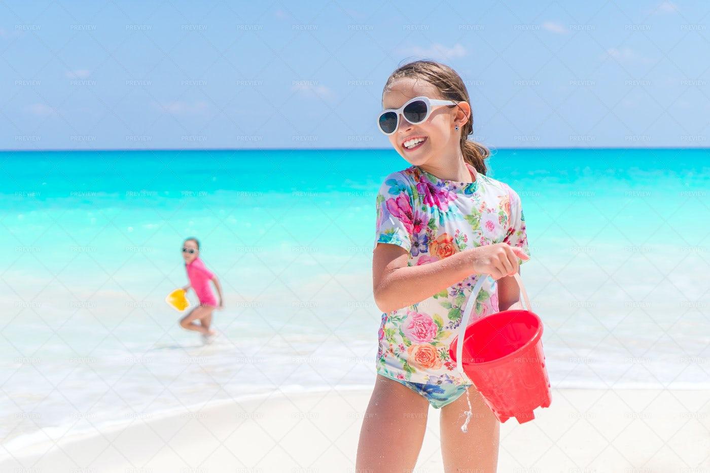 Girl Playing On Beach: Stock Photos