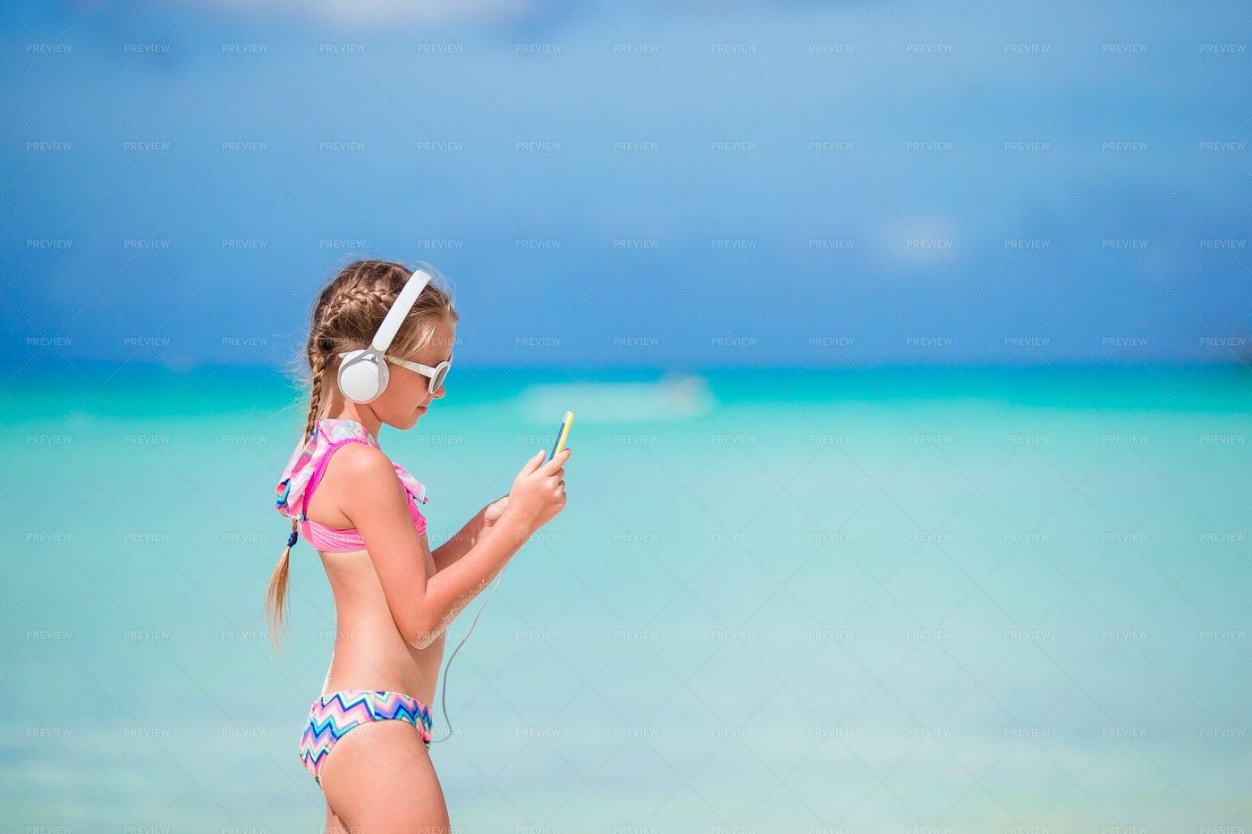 Headphones On The Beach: Stock Photos