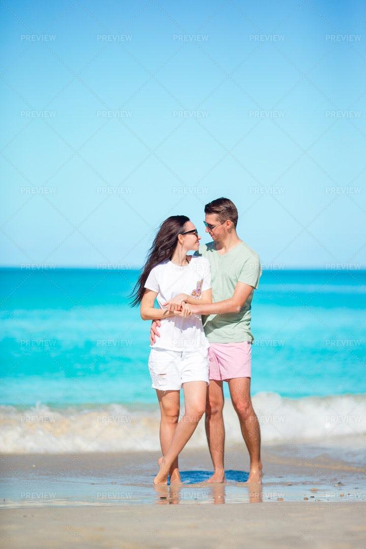 A Beach Vacation Embrace: Stock Photos