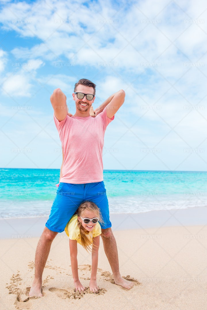Playing Together On The Beach: Stock Photos