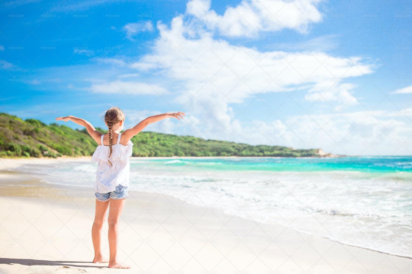 Young Girl Enjoys The Beach: Stock Photos