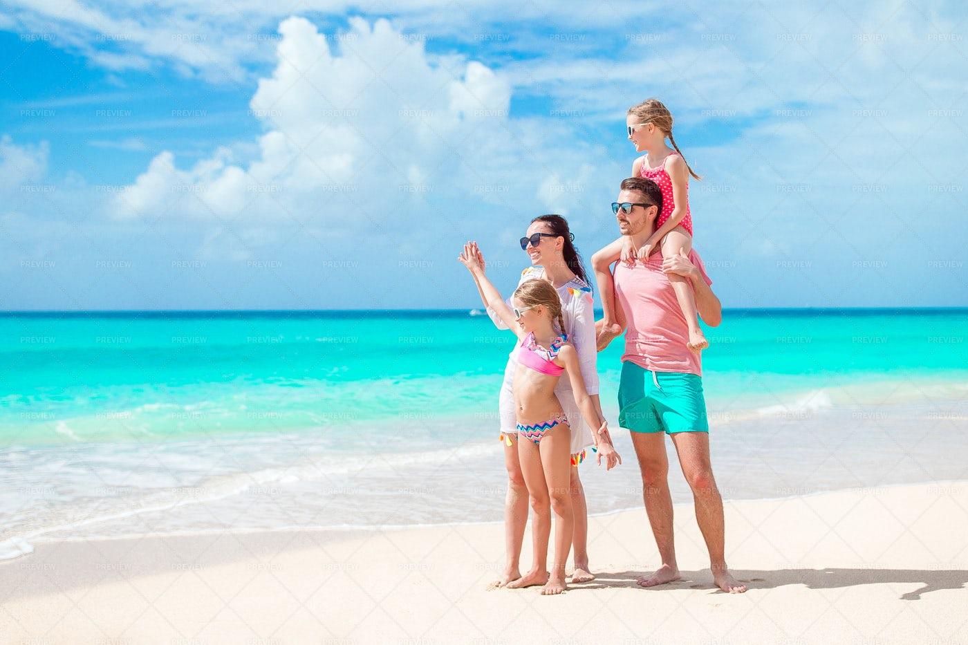 Family Looks To The Ocean: Stock Photos