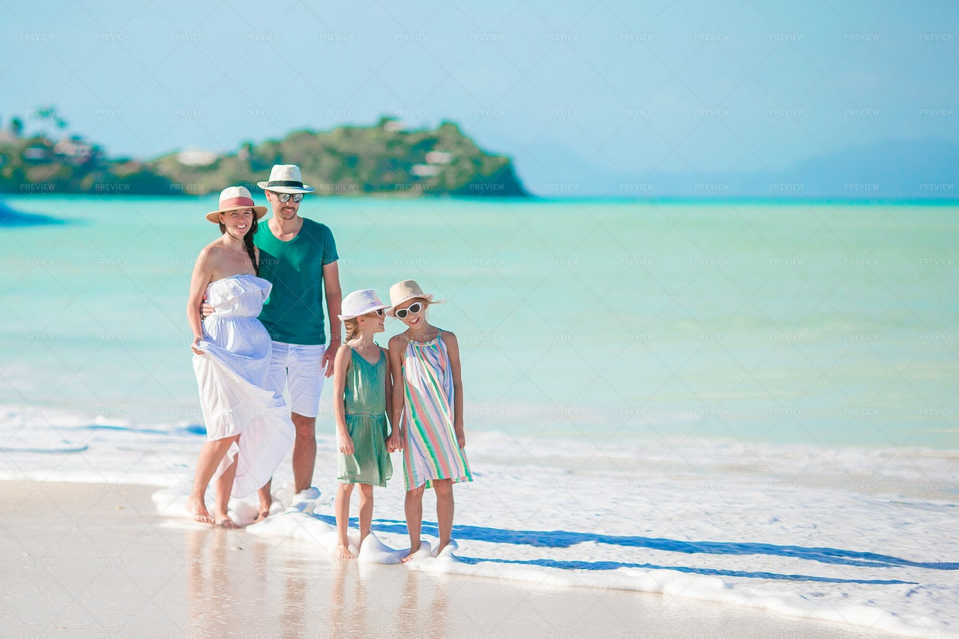 Young Family On The Beach: Stock Photos