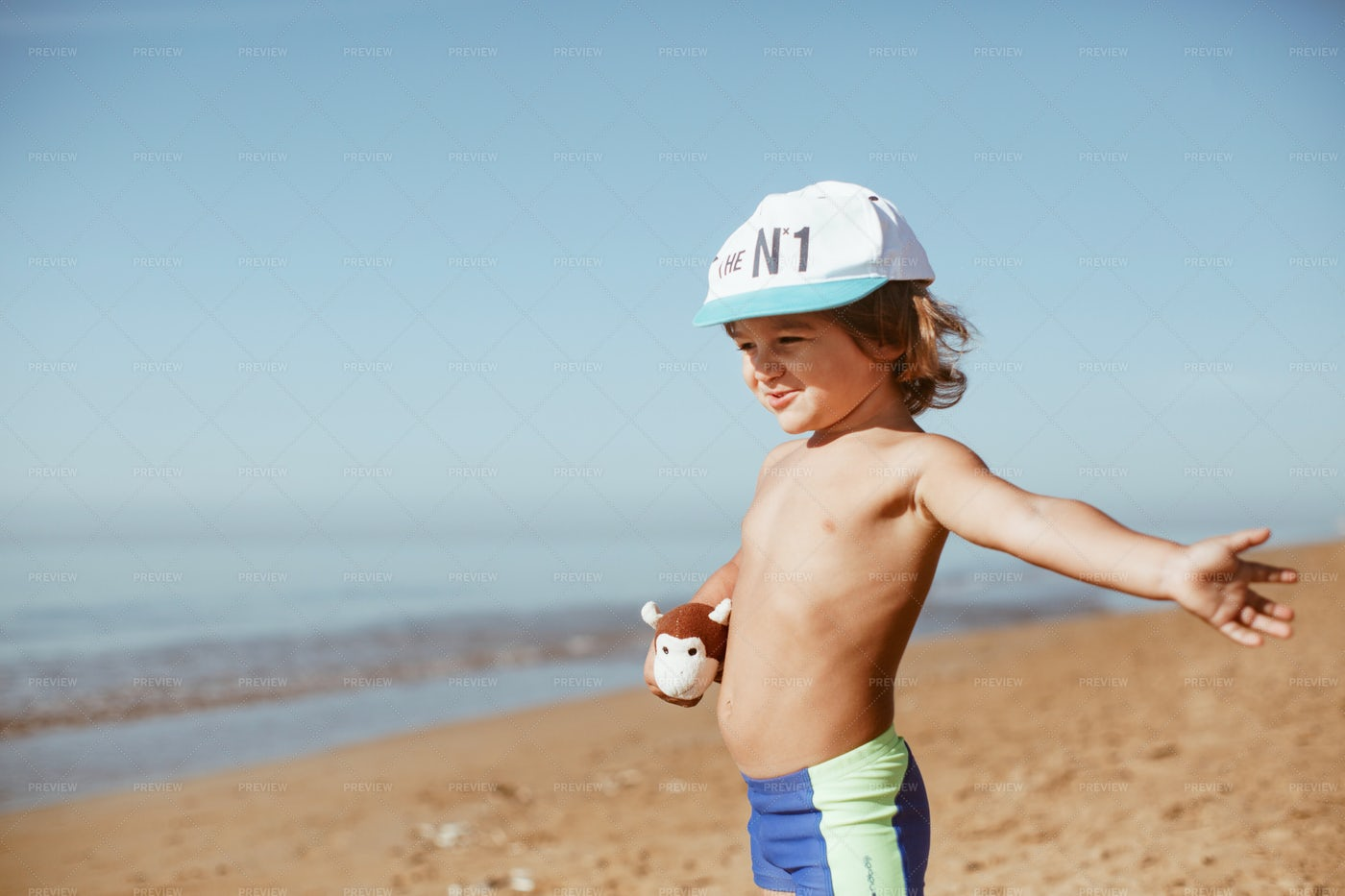 Boy Smiling At The Beach: Stock Photos