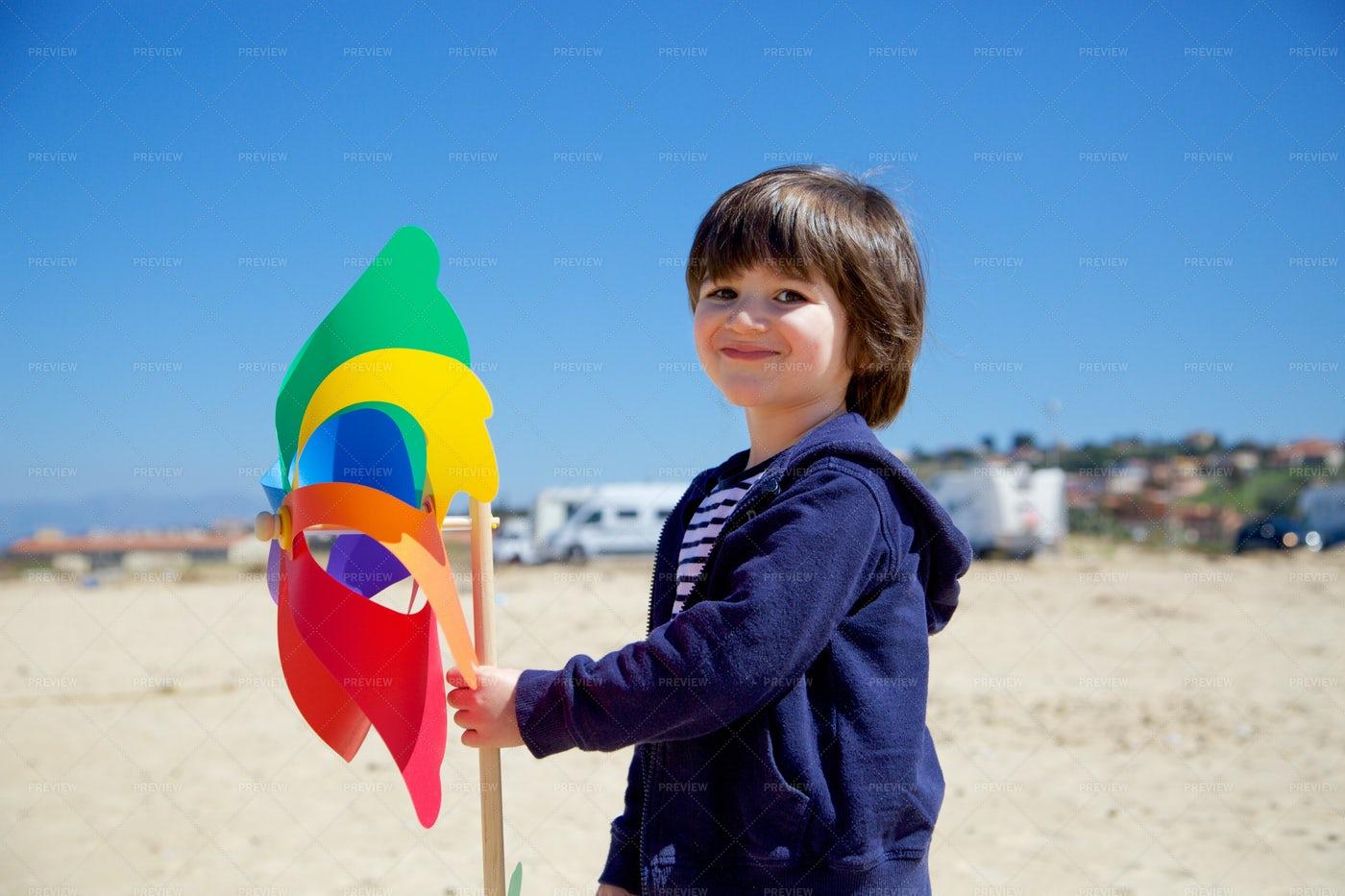Child WIth Pinwheel: Stock Photos
