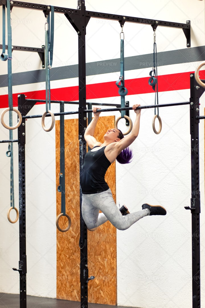 Woman Doing Pull-ups On Rings: Stock Photos