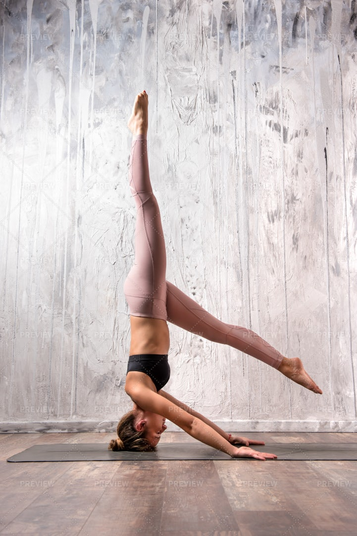 Fit Woman Doing A Headstand: Stock Photos