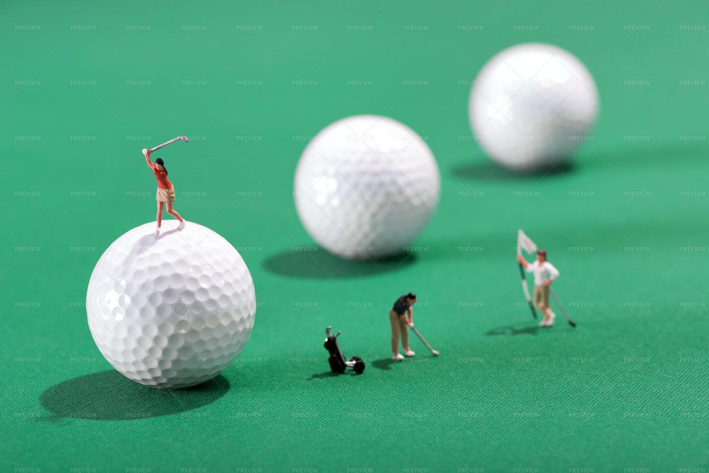 Miniature Figures Of Golfers: Stock Photos