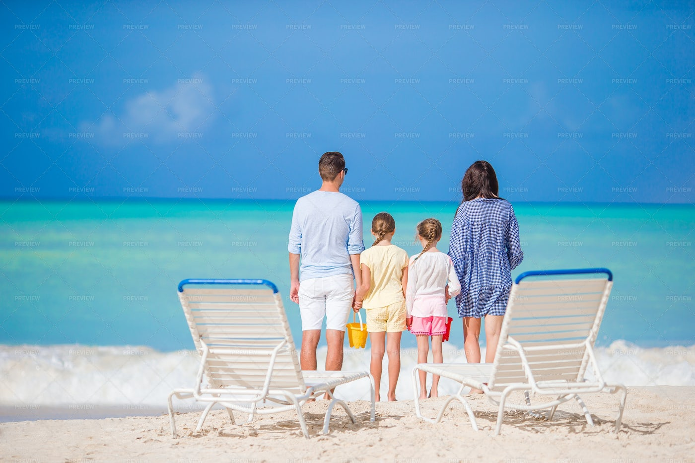 Family Standing At The Shore: Stock Photos