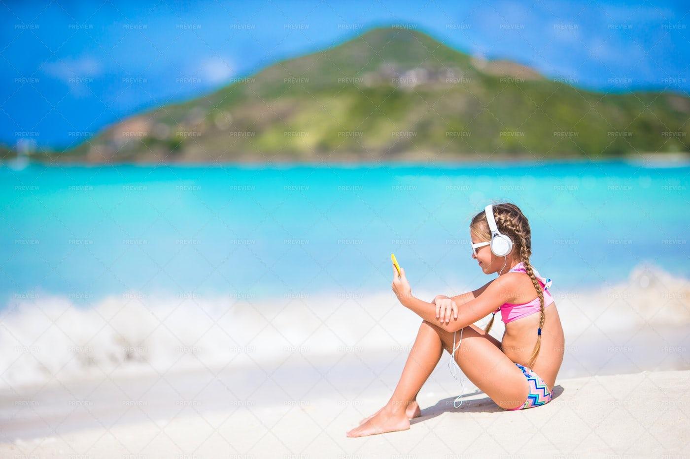 Girl Enjoys Beach Music: Stock Photos