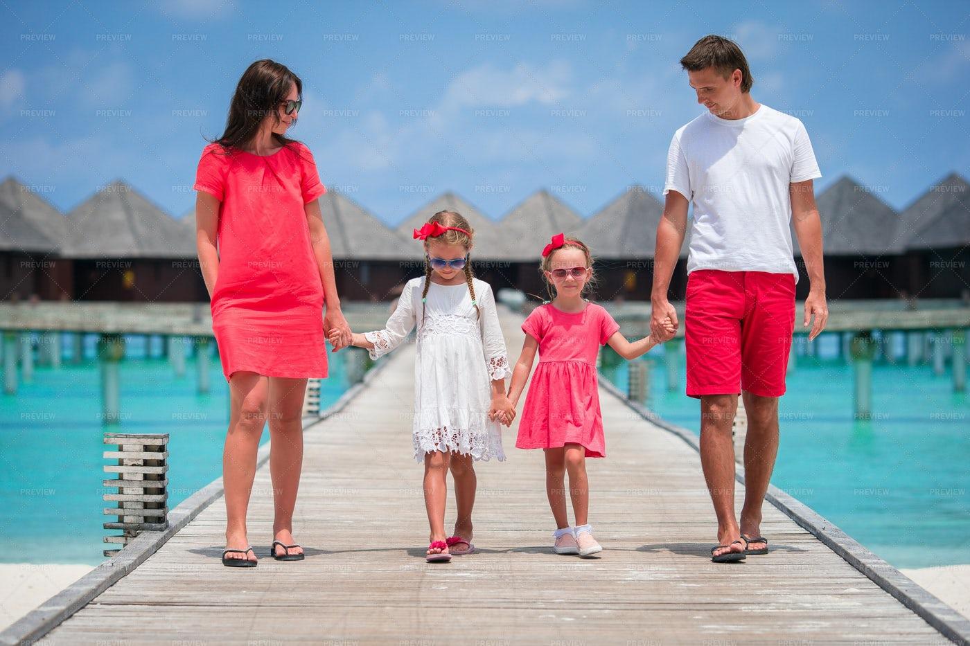 Happy Family On The Pier: Stock Photos