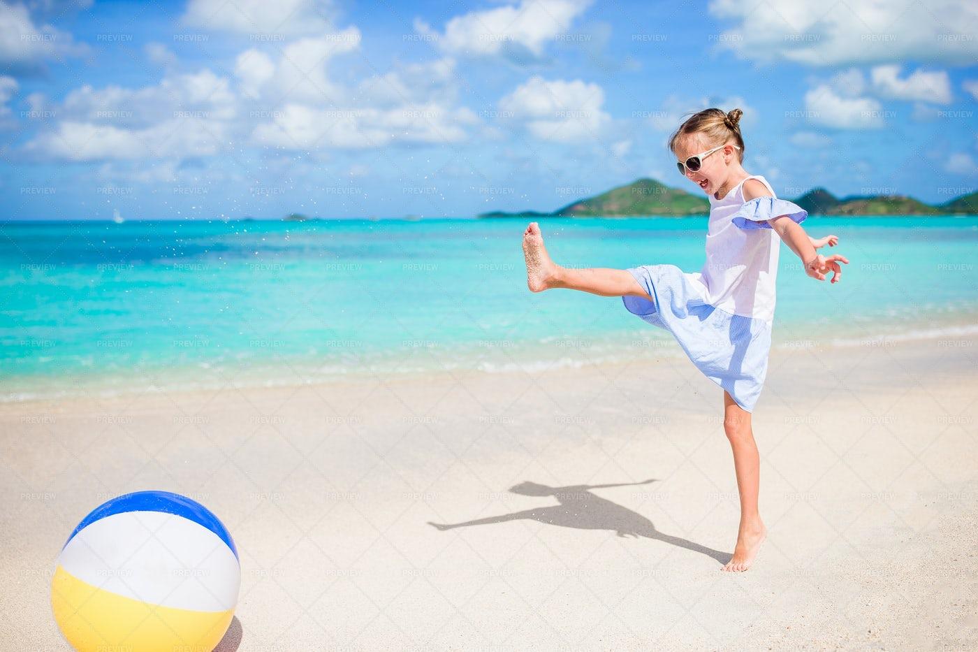 Girl Playing With Ball: Stock Photos