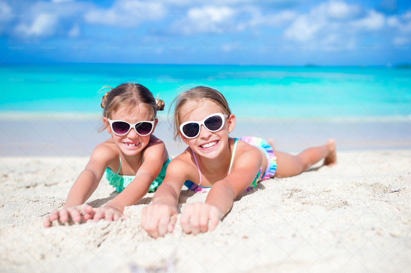Girls On Sandy Beach: Stock Photos