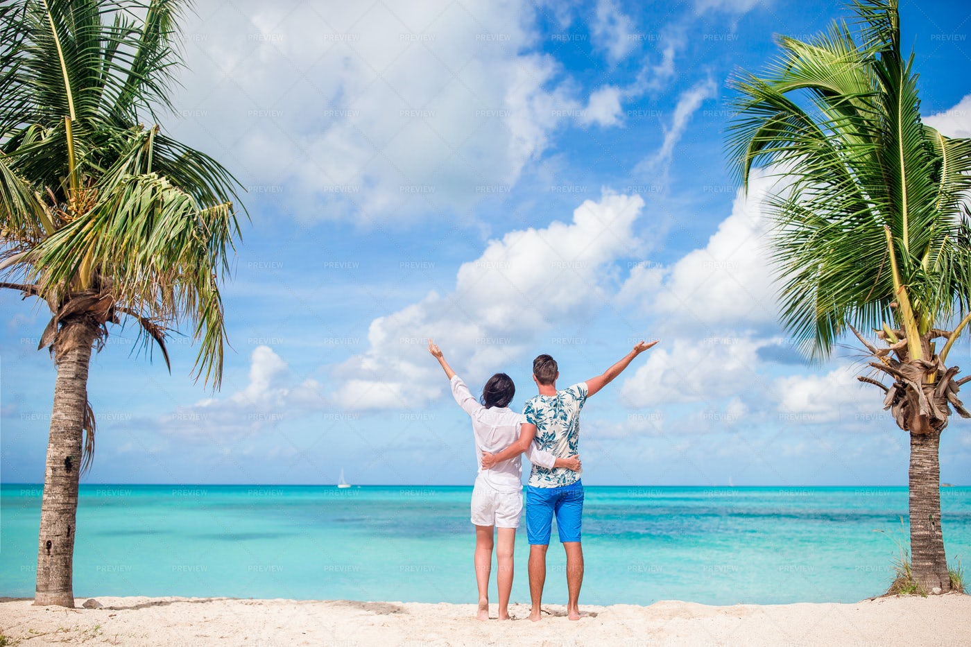 Couple Enjoying The Beach: Stock Photos