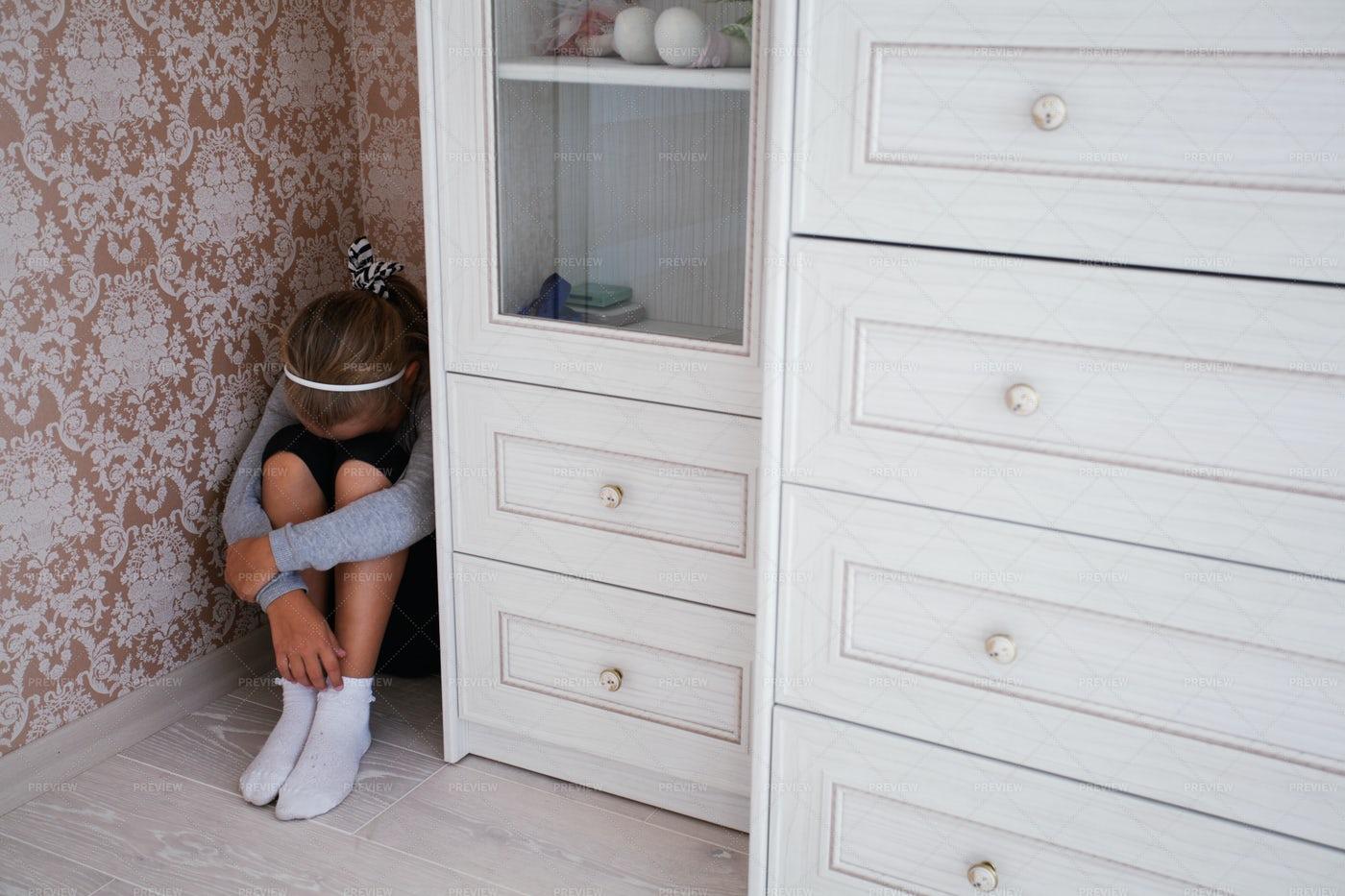 Sad Girl In Corner: Stock Photos