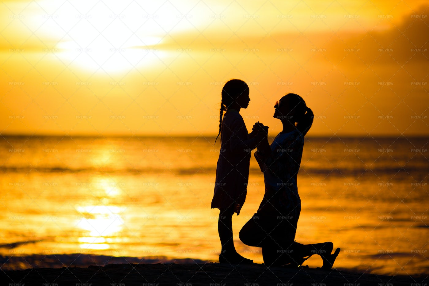 Girl And Mother Silhouette: Stock Photos