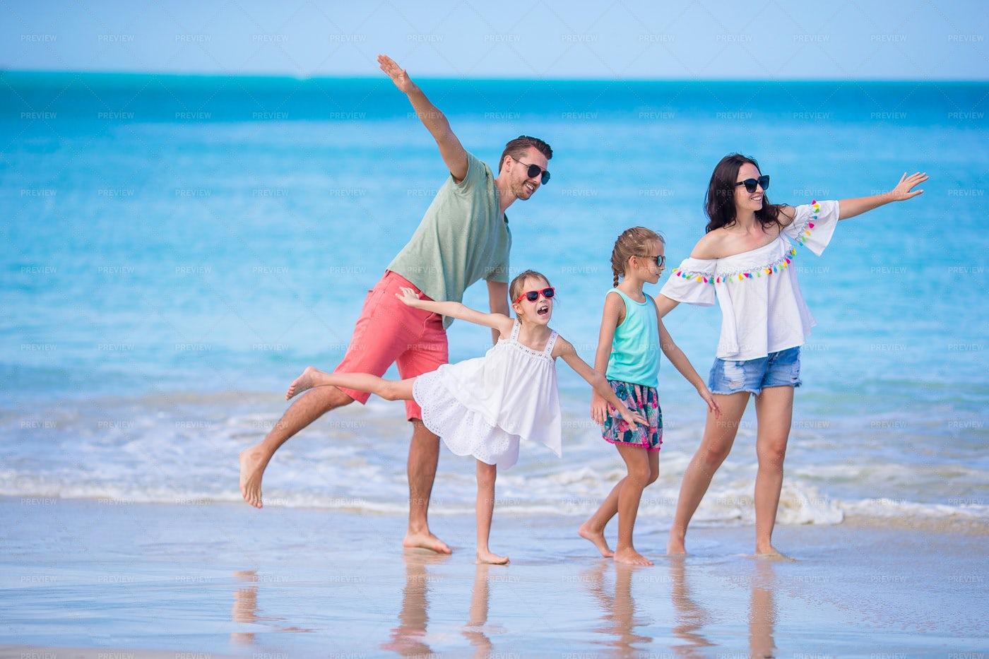 Happy Family On Beach: Stock Photos