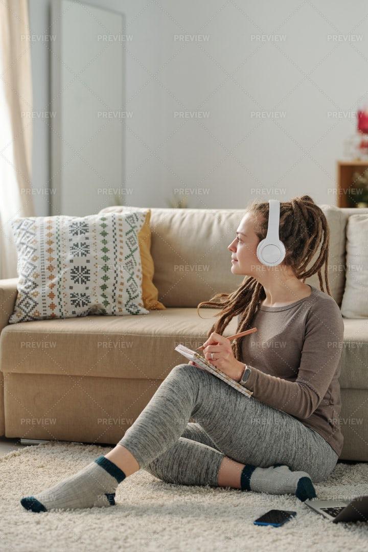 Female With Headphones Getting...: Stock Photos