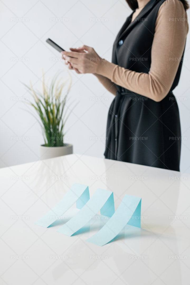 Row Of Blue Paper Charts On Desk On...: Stock Photos