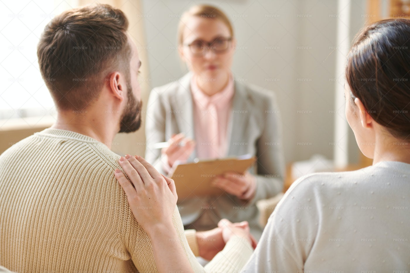 Couple Consulting With Counselor: Stock Photos
