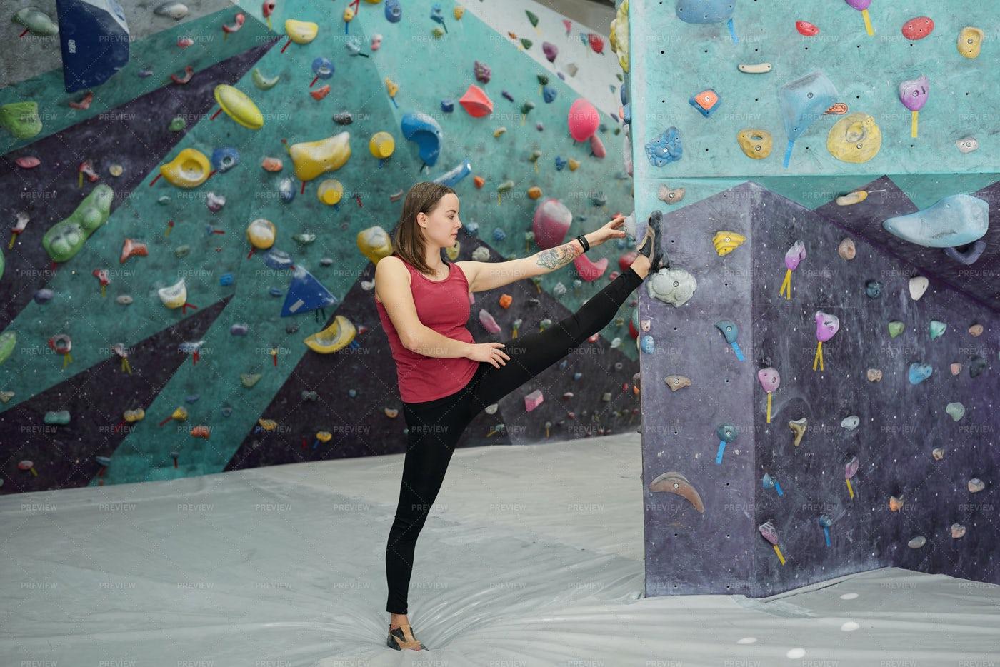 Young Sportswoman Keeping One Leg...: Stock Photos