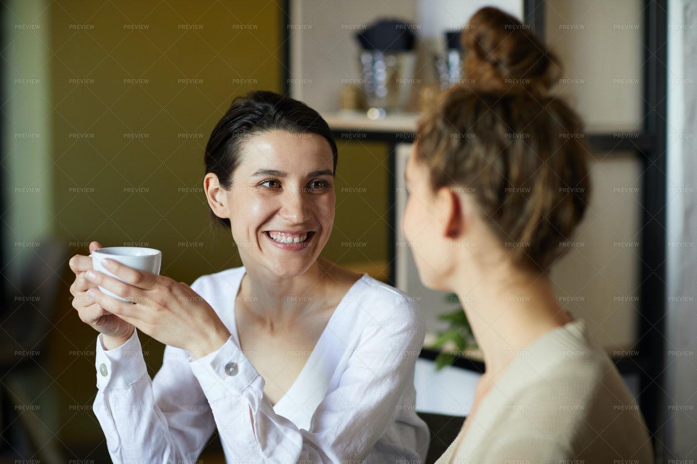Girls Talking In Cafe: Stock Photos