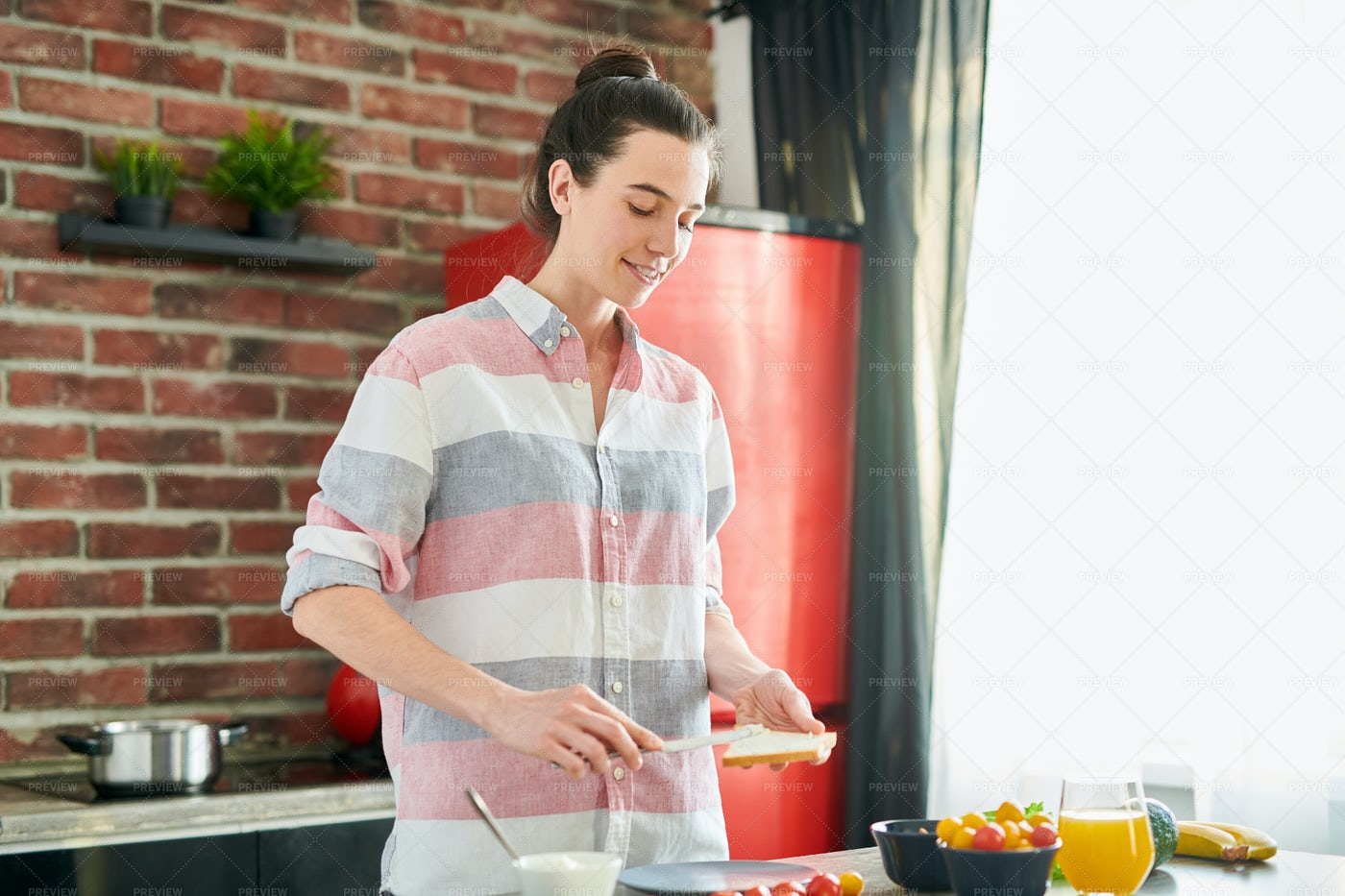 Young Woman Making Breakfast: Stock Photos