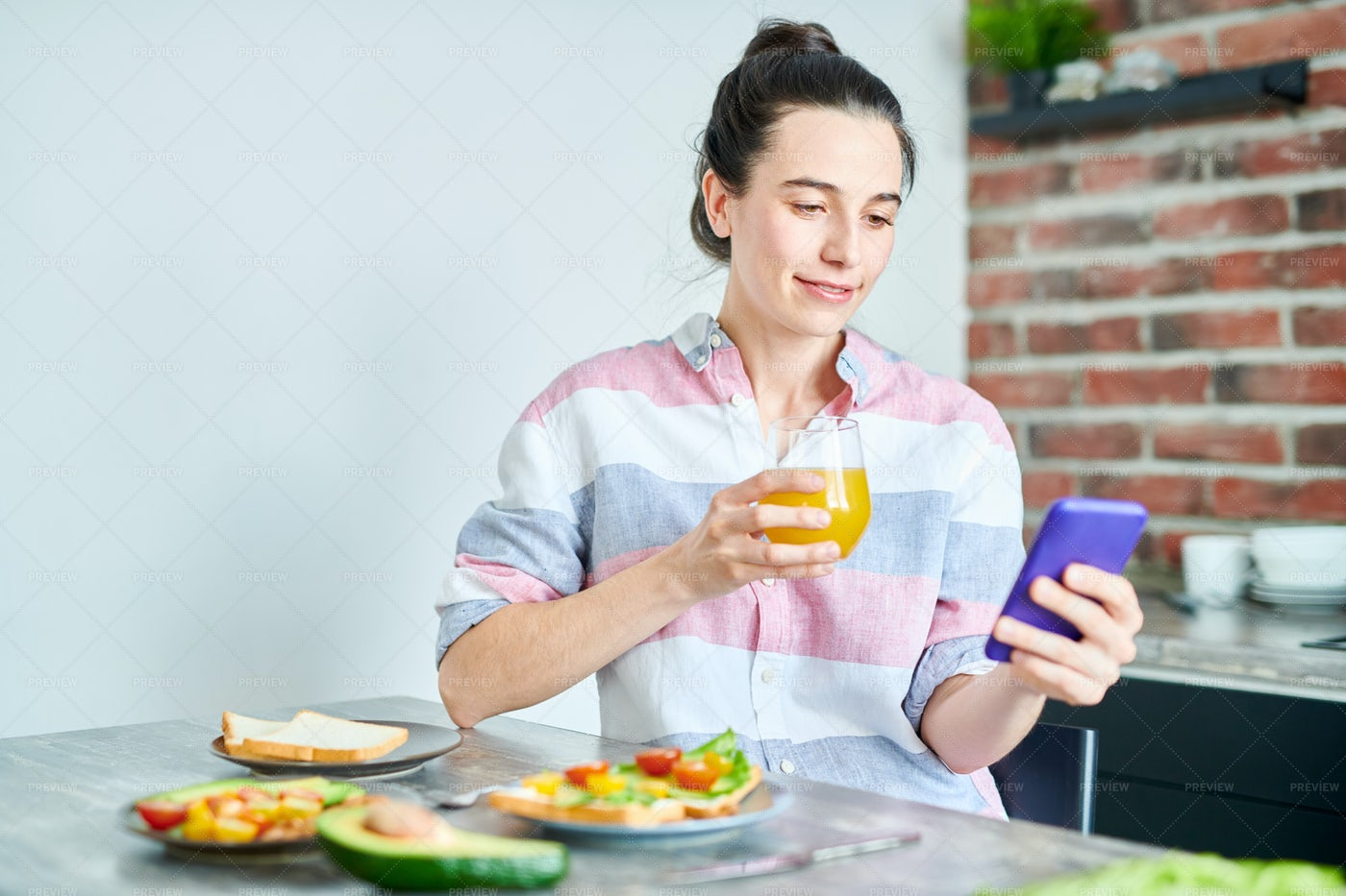 Woman Using Smartphone At Breakfast: Stock Photos