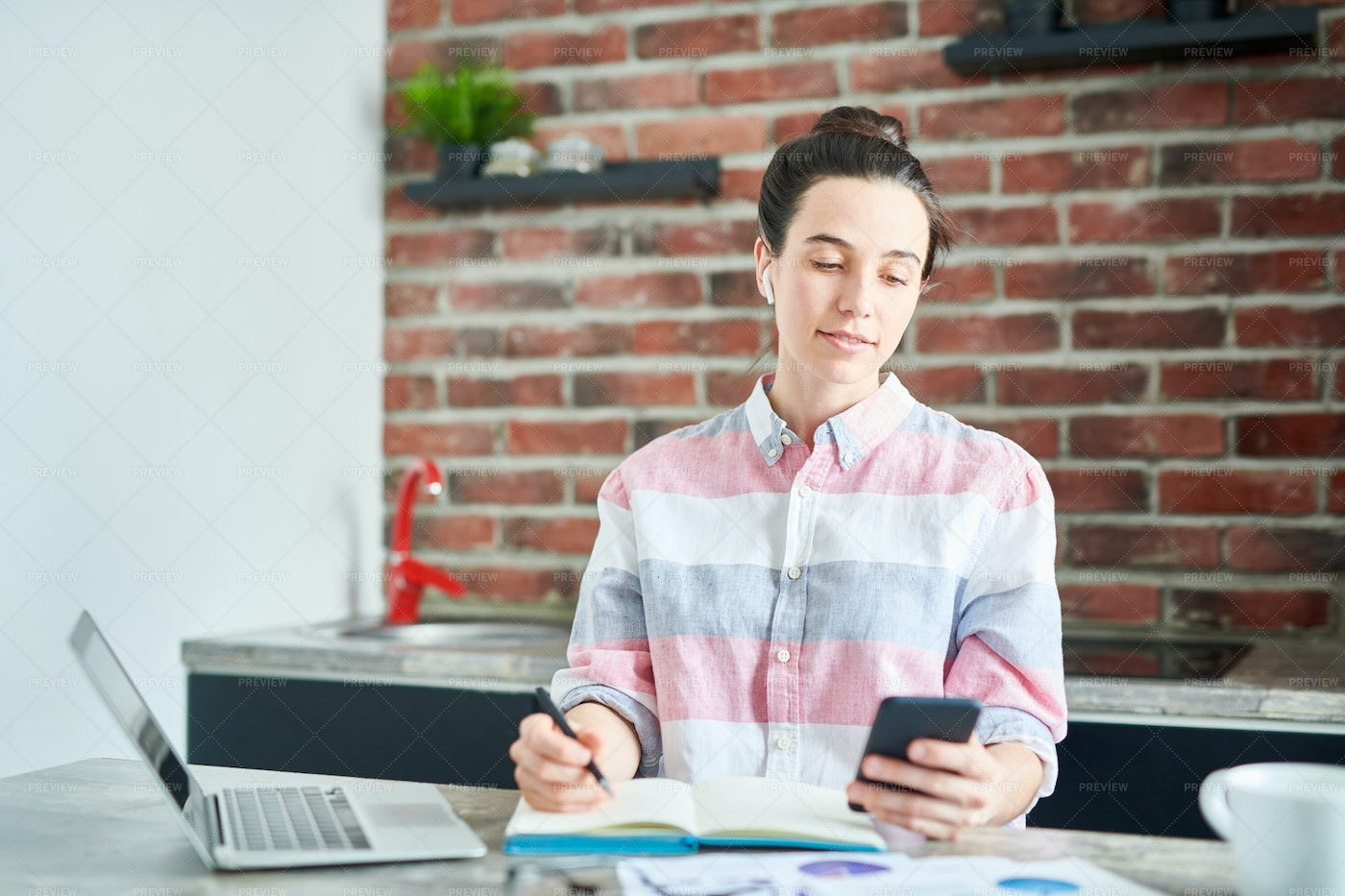 Modern Young Woman Working From...: Stock Photos