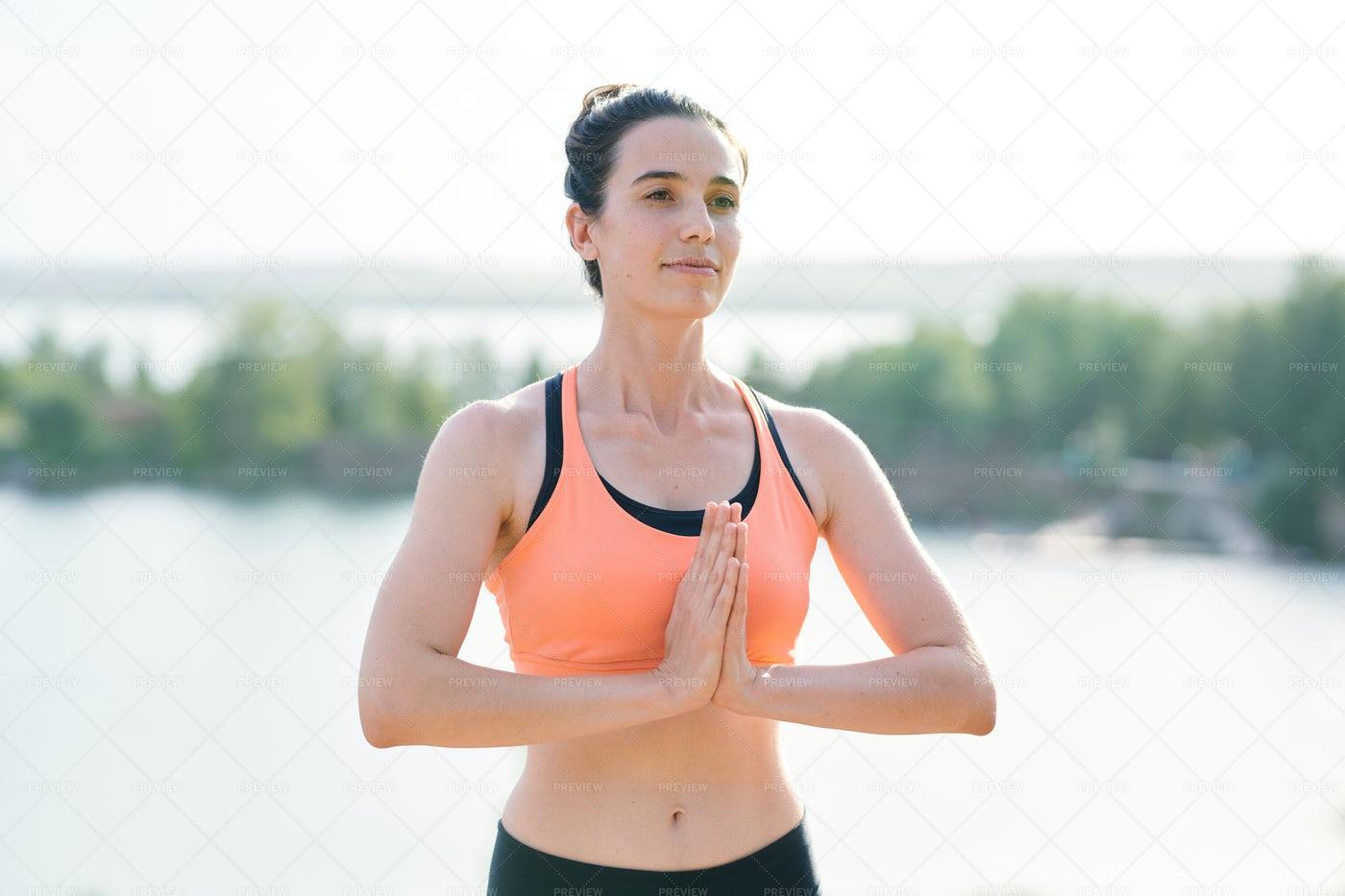 Content Yoga Coach Welcoming...: Stock Photos