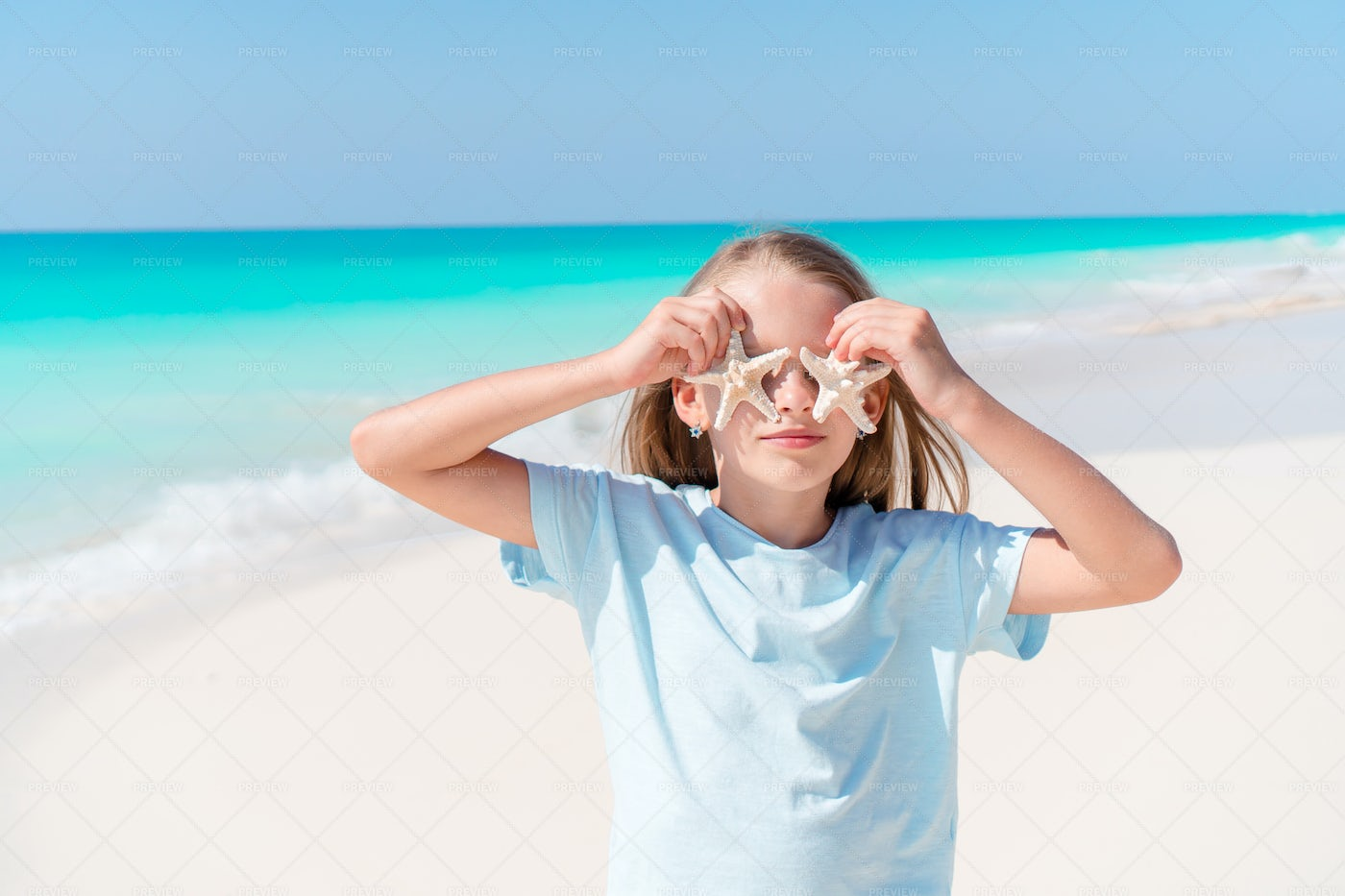 Starfish Over Her Eyes: Stock Photos