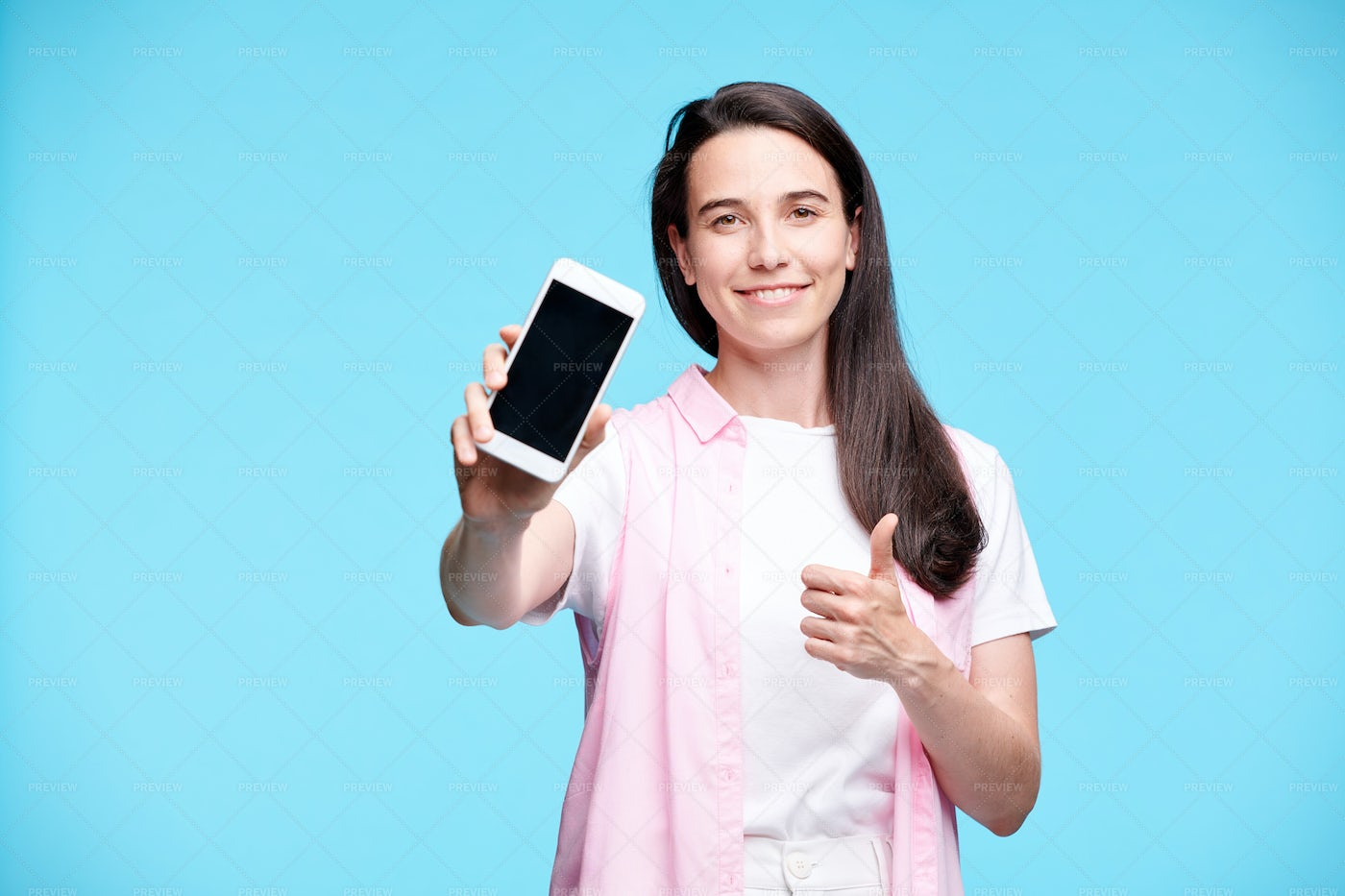 Happy Young Consumer Presenting You...: Stock Photos