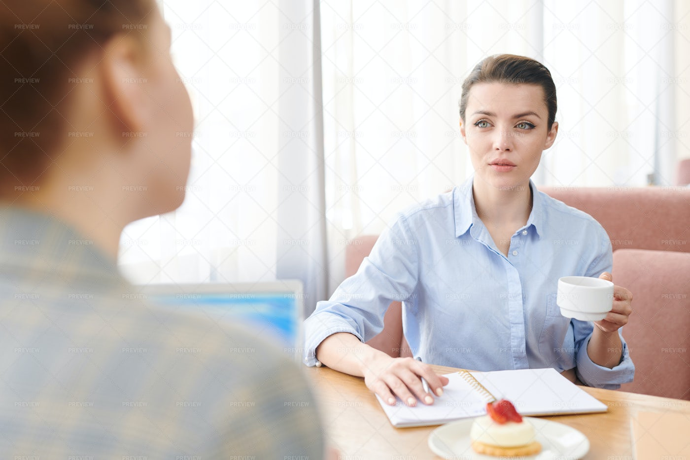 Discussing Business Over Cup Of...: Stock Photos