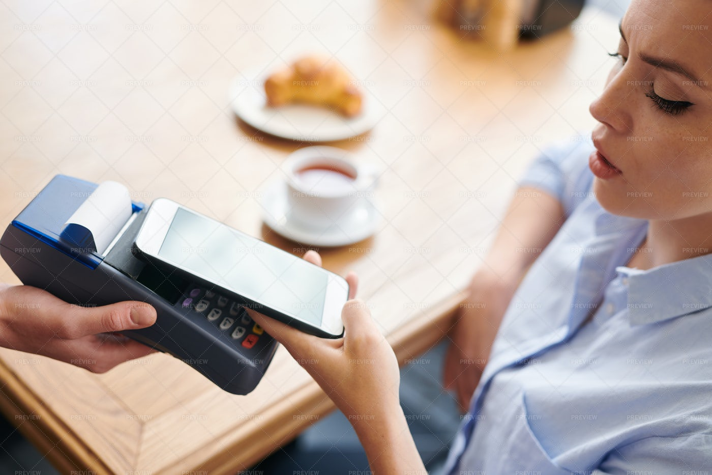 Paying With Smartphone In...: Stock Photos