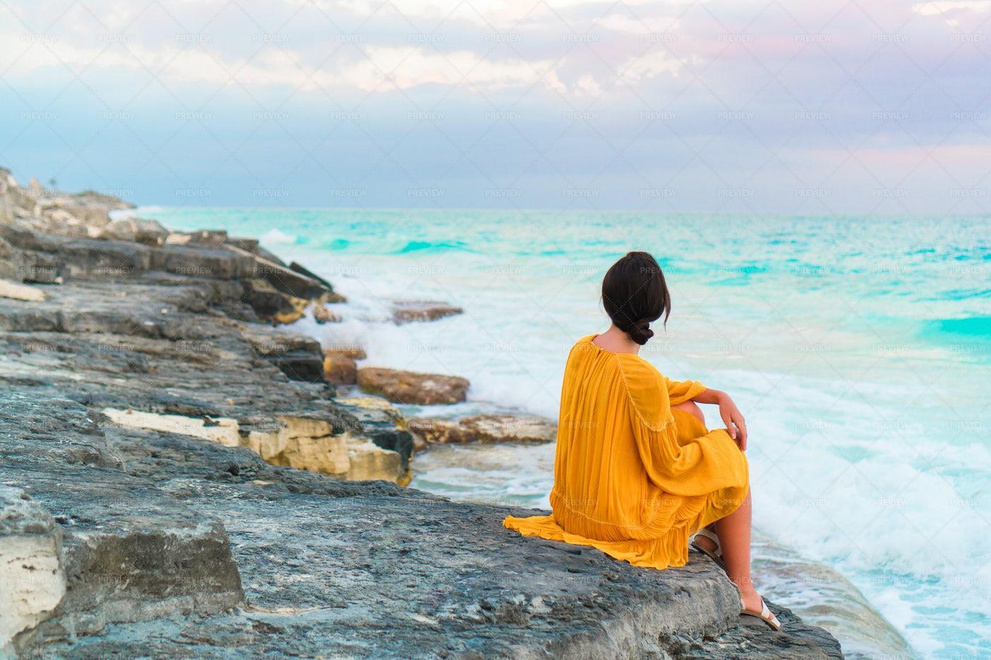 Woman Enjoys The Ocean View: Stock Photos