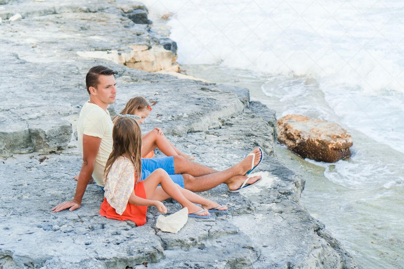 Sitting On The Beach Rocks: Stock Photos