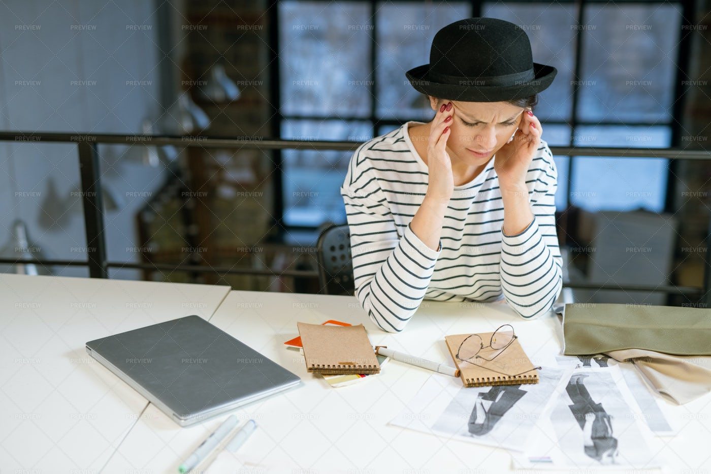 Tired Designer In Casualwear Trying...: Stock Photos