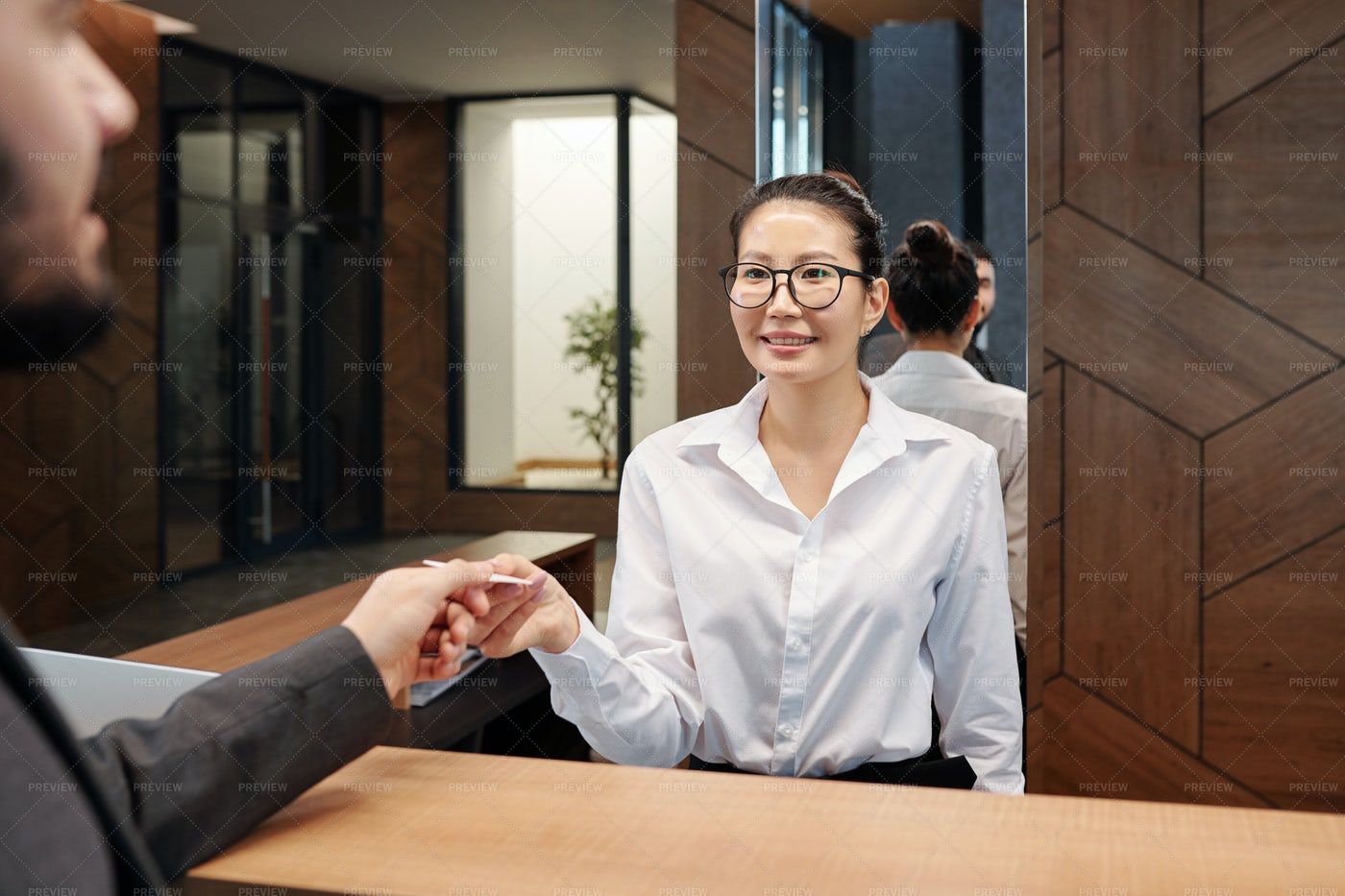 Young Asian Female Receptionist...: Stock Photos
