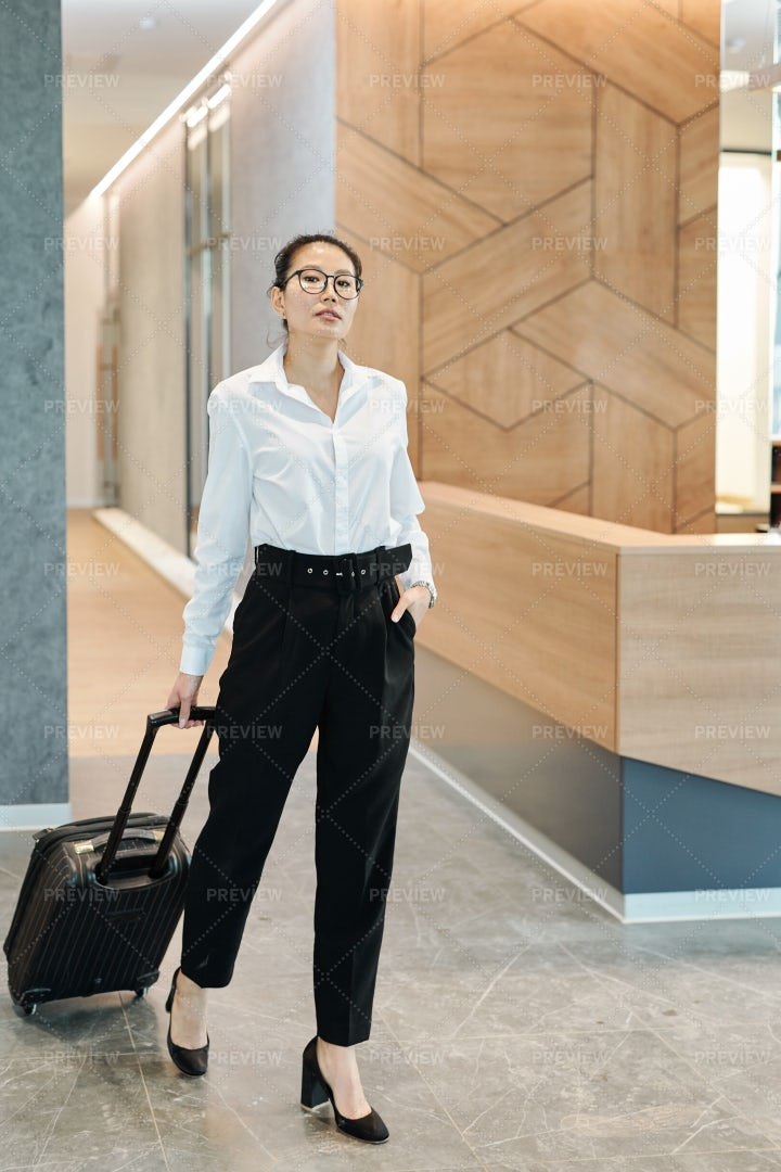 Businesswoman Moving Along Hotel...: Stock Photos