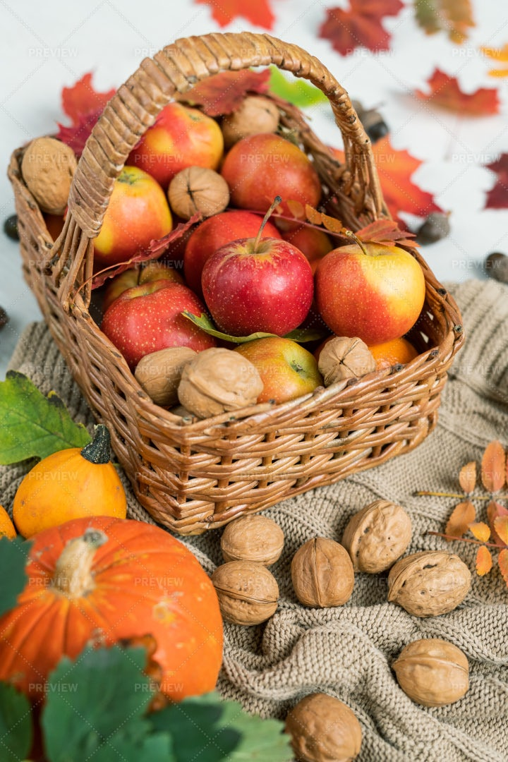 Basket With Ripe Apples, Walnuts...: Stock Photos