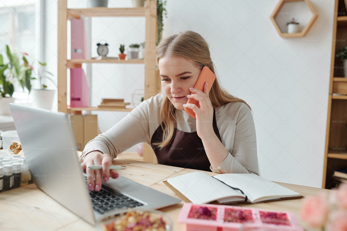 Busy Female With Smartphone Sitting...: Stock Photos