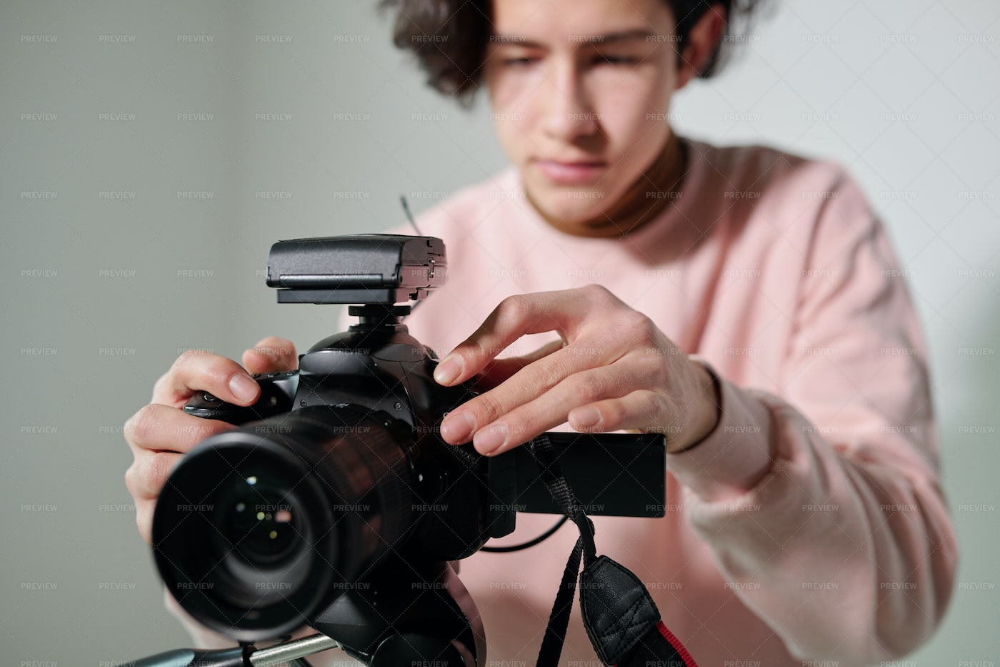 Hands Of Young Cameraman In Powdery...: Stock Photos