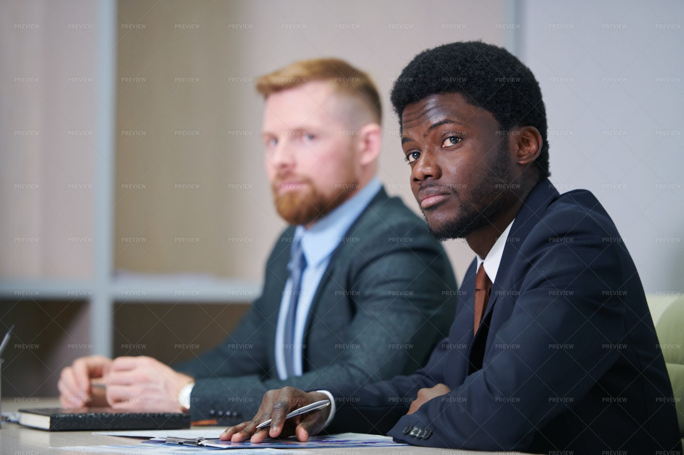 Young African Businessman In Suit...: Stock Photos