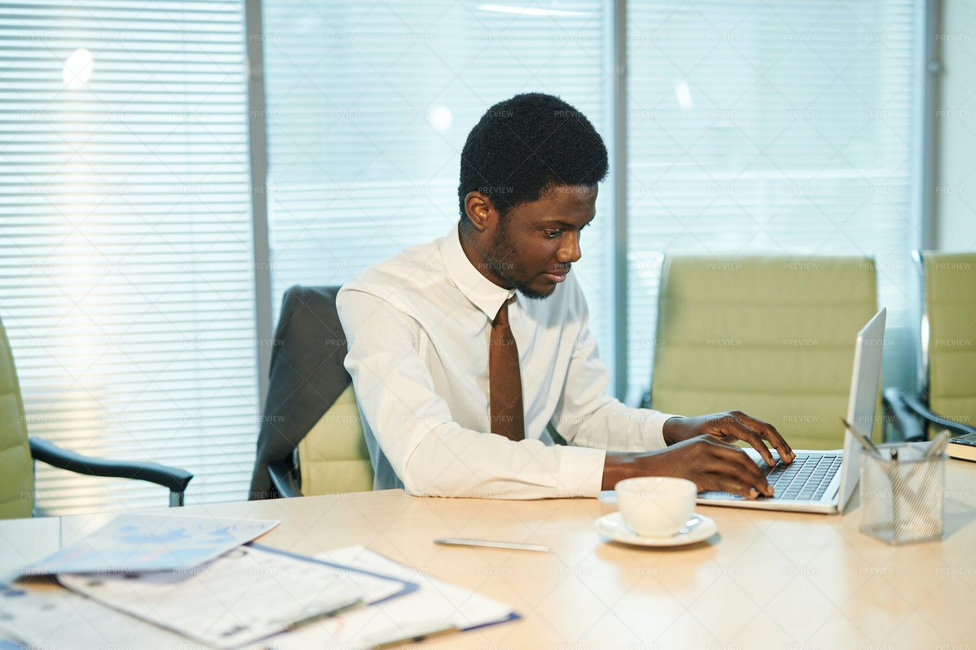 Young African Analyst Working Over...: Stock Photos
