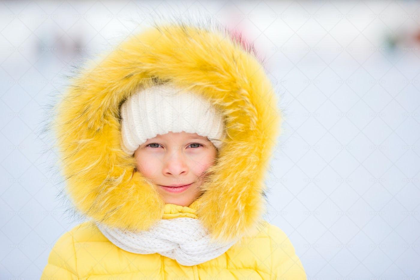 Her Yellow Winter Coat: Stock Photos