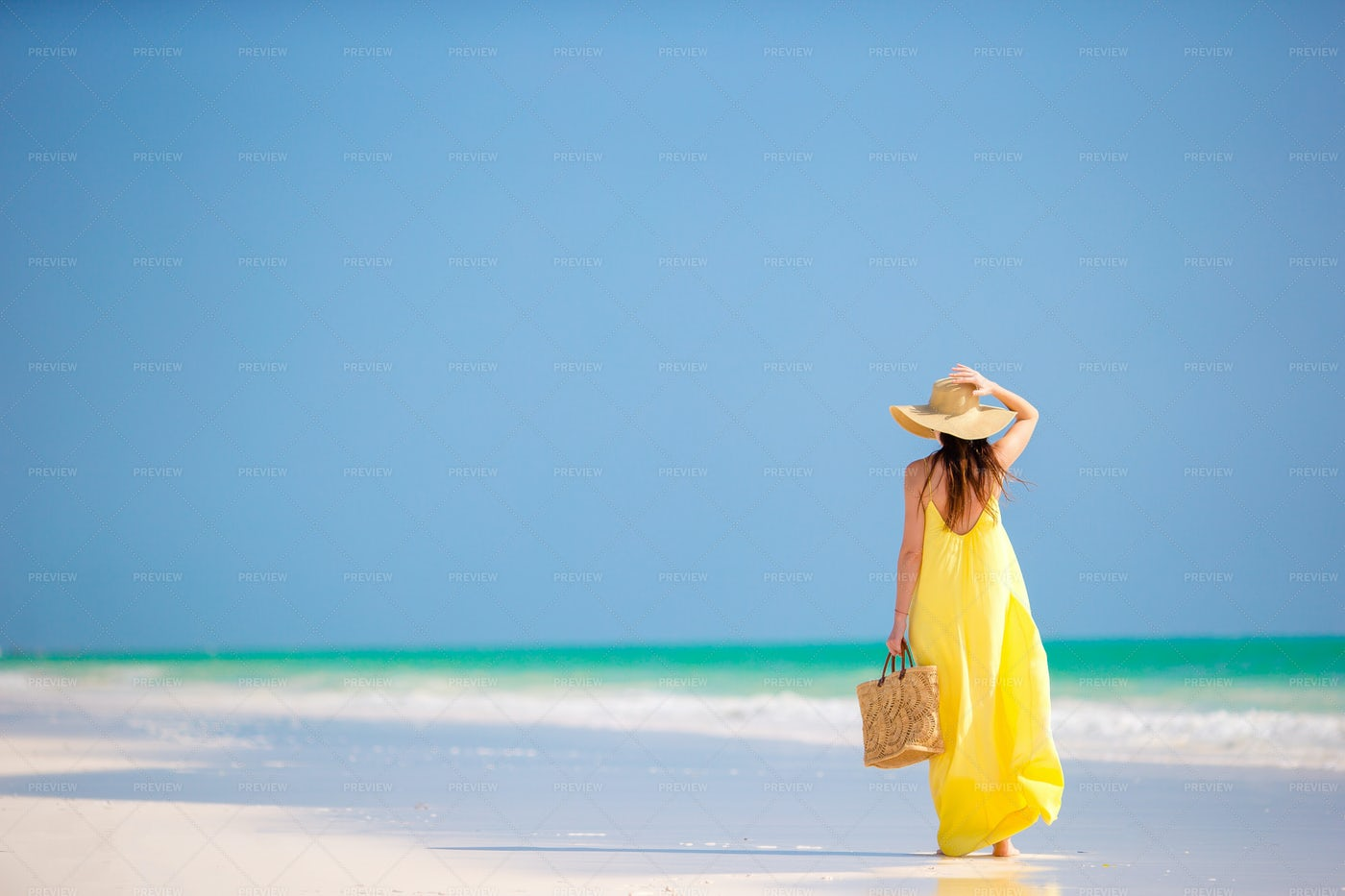 Beach Woman In Yellow: Stock Photos