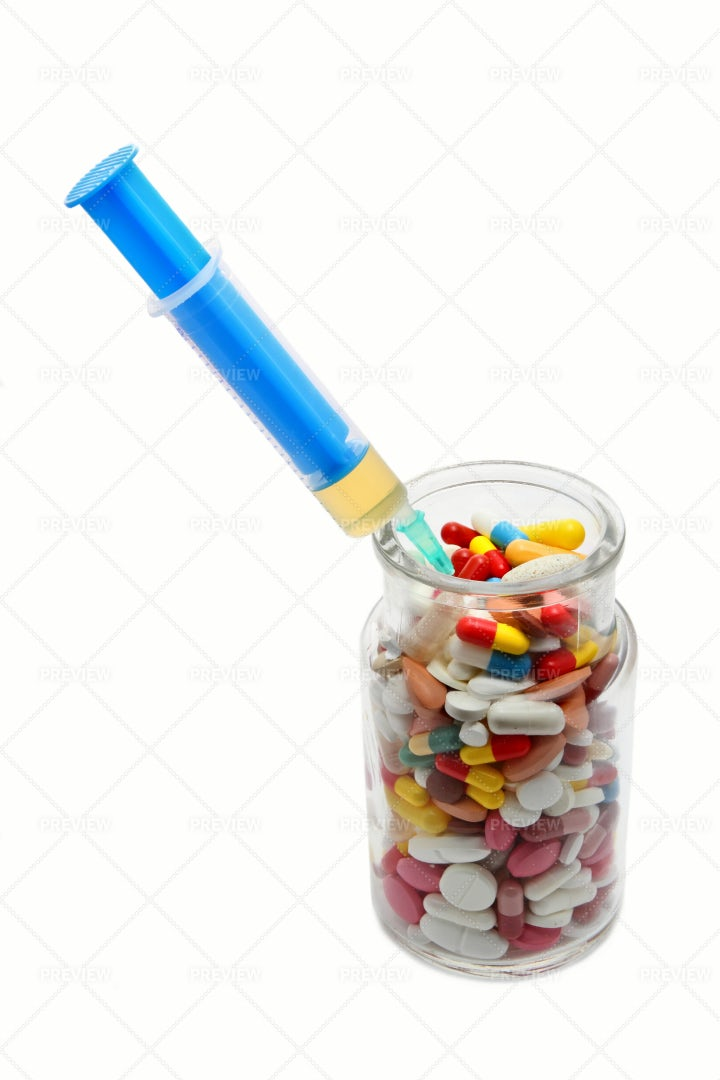 Tablets With Syringe: Stock Photos