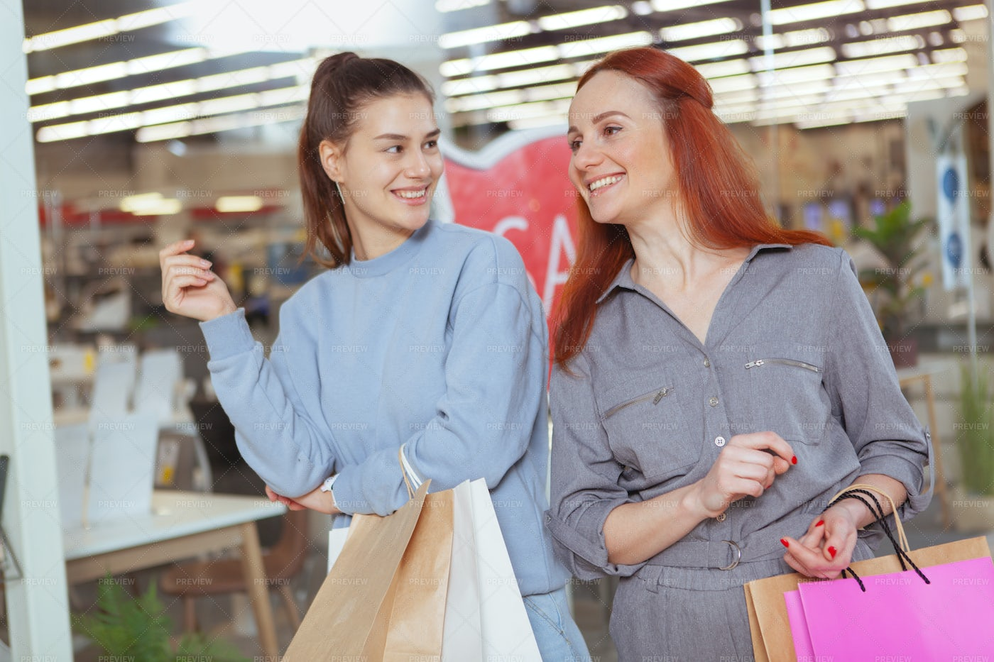 Friends Shopping At The Mall: Stock Photos